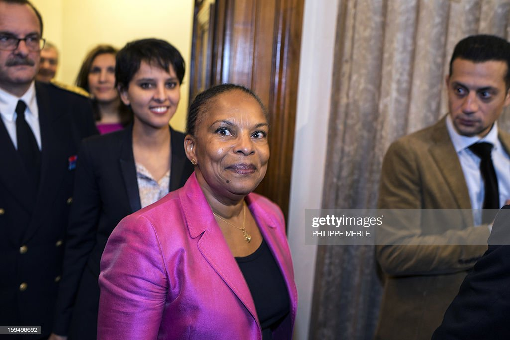French Justice Minister Christiane Taubira (C), followed by French Minister for Women's Rights and Government Spokeperson, Najat Vallaud-Belkacem, arrives to a ceremony on January 14, 2013 in Lyon, in central France, to inaugurate the Courthouse after a four-year revamp, during a formal sitting of the appeal court. AFP PHOTO PHILIPPE MERLE