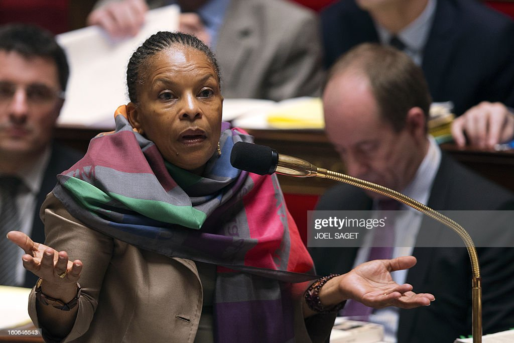 French Justice Minister Christiane Taubira gives a speech during the debate to allow gay couples to get married and adopt children on February 4, 2013 at the National Assembly in Paris. Two days before, Members of Parliament voted 249-97 in favour of Article One of the draft law, which redefines marriage as being a contract between two people rather than necessarily between a man and a woman.