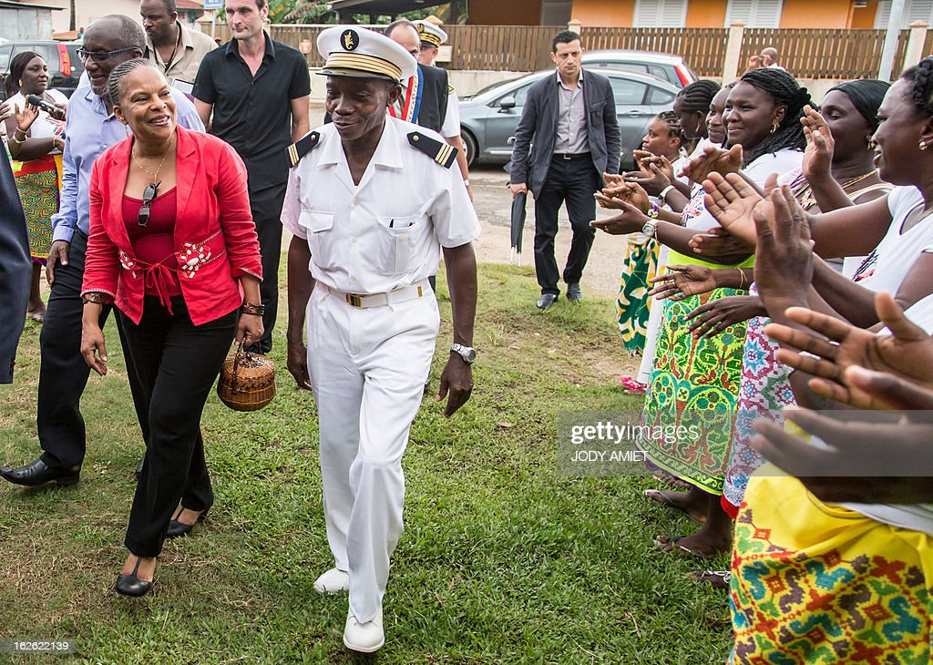 French Justice minister Christiane Taubira (L) is welcomed by inhabitants as she visits the neighbourhood of Saramaca, on February 23, 2013 in Kourou, as part of her five-day visit to the French French overseas territory of Guiana.