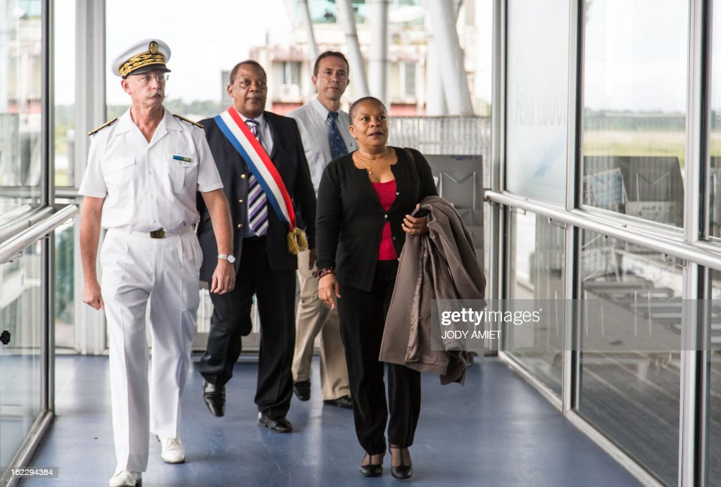 French Justice Minister Christiane Taubira (R) is welcomed by the French overseas territory of Guiana's Prefect Denis Labbe (L) and Matoury's Mayor Jean-Claude Roumillac as she arrives on February 21, 2013 at the Cayenne's airport in Matoury, to begin a five-day official visit in Guiana. AFP PHOTO JODY AMIET