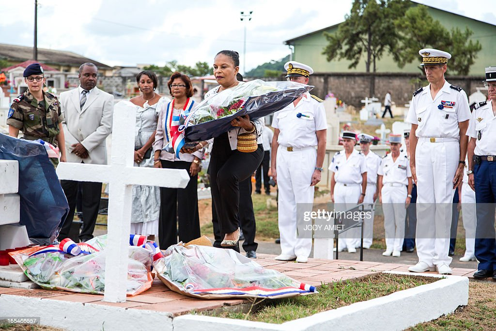 French Justice Minister Christiane Taubira (C) lays a wreath on November 2, 2012 in the military section of Cayenne's cemetery, in French overseas region of Guiana, during a ceremony of remembrance dedicated to soldiers and war victims.