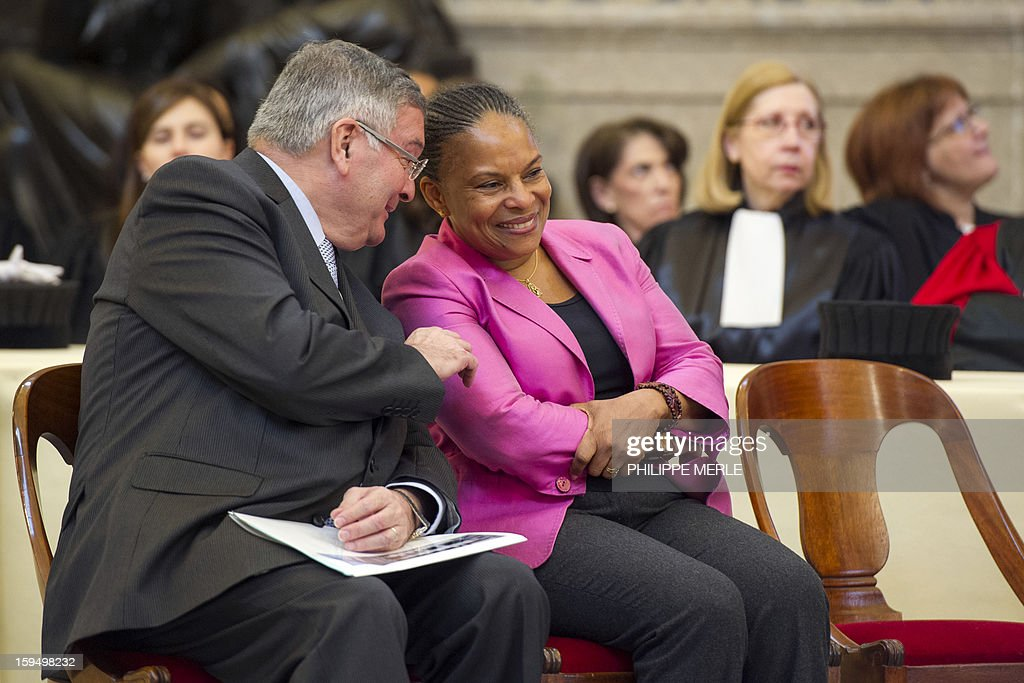 French Justice Minister Christiane Taubira (C) listens to French former Justice Minister Michel Mercier (L), on January 14, 2013 in Lyon, in central France, during a formal sitting of the appeal court and the inaugurating ceremony of the Courthouse, after a four-year revamp.