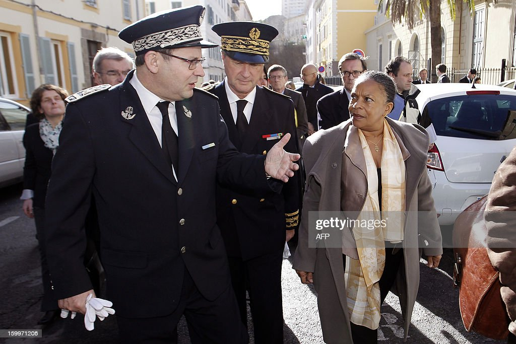 French Justice Minister Christiane Taubira (R) listens to the director of the directeur of interegional penitentiary system, M.Peron (L), flanked by Patrick Strzoda (C), prefect of Corse-Du-Sud, on January 24, 2013, in Ajaccio, French mediterranean island of Corsica.