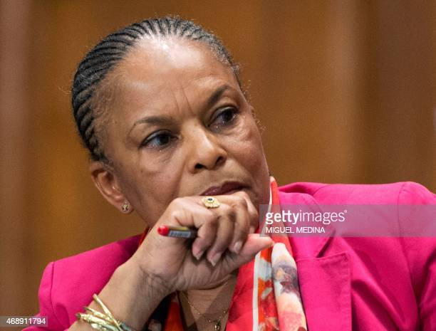 French Justice Minister Christiane Taubira listens to the French Education Minister speaking during a meeting with public prosecutors and chief...