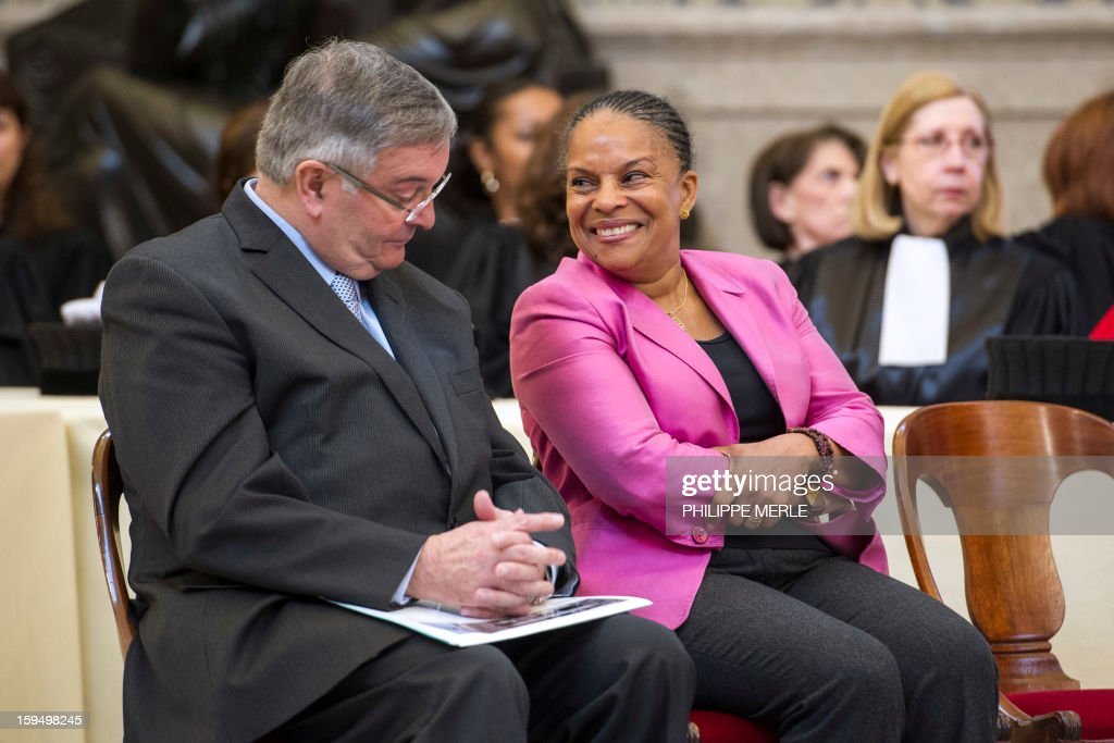French Justice Minister Christiane Taubira (C) looks at French former Justice Minister Michel Mercier (L), on January 14, 2013 in Lyon, in central France, during a formal sitting of the appeal court and the inaugurating ceremony of the Courthouse, after a four-year revamp.