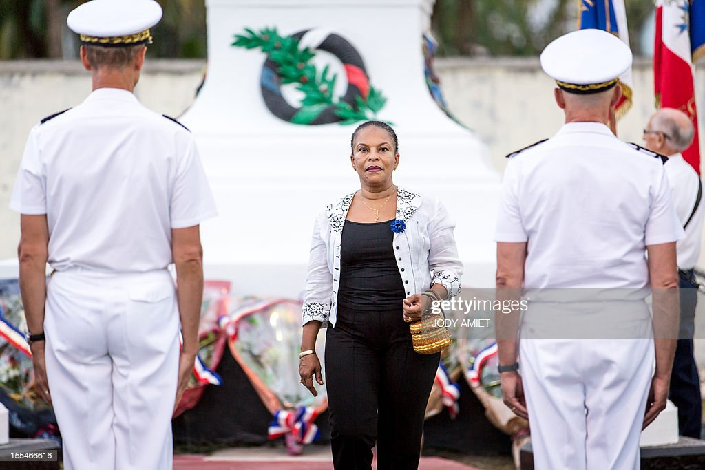 French Justice Minister Christiane Taubira looks on after laying a wreath during a ceremony of remembrance dedicated to soldiers and war victims, on November 2, 2012, in the military section of Cayenne's cemetery, in French overseas region of Guiana. AFP PHOTO / JODY AMIET