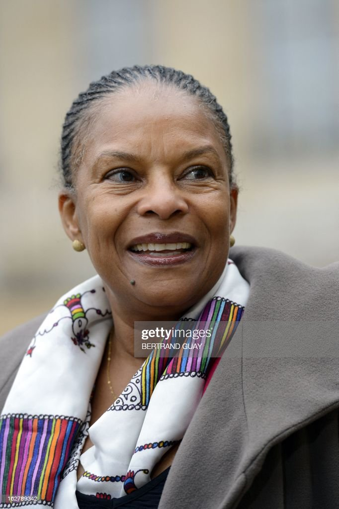 French Justice Minister Christiane Taubira looks on as she leaves the Elysee Presidential Palace in Paris on February 27, 2013, at the end of the weekly cabinet meeting. AFP PHOTO BERTRAND GUAY