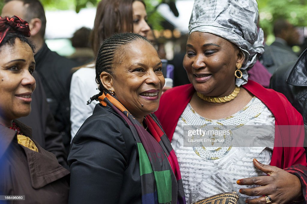 French Justice Minister <a gi-track='captionPersonalityLinkClicked' href=/galleries/search?phrase=Christiane+Taubira&family=editorial&specificpeople=3798541 ng-click='$event.stopPropagation()'>Christiane Taubira</a> (C) meets with guests as she attends a ceremony marking the abolition of slavery in the Jardins du Luxembourg on May 10, 2013 in Paris, France. Taubira Law was passed in May 2001 acknowledging slavery and the Atlantic slave trade as crimes against humanity.