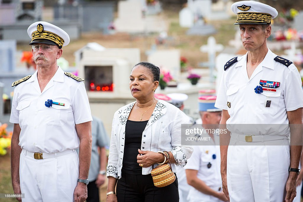 French Justice Minister Christiane Taubira (2ndL) pays respect after laying a wreath, surrounded by the Prefect of Guiana, Denis Labbe (L) and General Bernard Metz (R), commander of the Armed Forces in French Guiana, on November 2, 2012, in the military section of Cayenne's cemetery, in French overseas region of Guiana, during a ceremony of remembrance dedicated to soldiers and war victims.