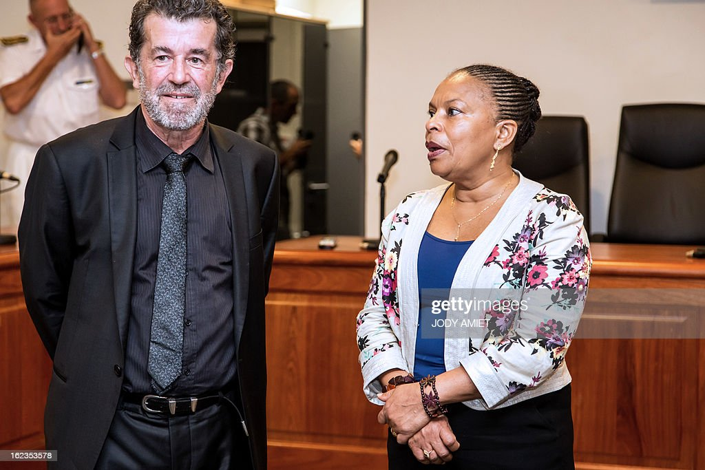 French Justice Minister Christiane Taubira (R), speaks with the president of the Court of Appeal Pierre Gouzenne (L) before a meeting at he headquarters of the Court of Appeal in Cayenne, on February 22, 2013, as part a five-day oficial visit in Guiana.