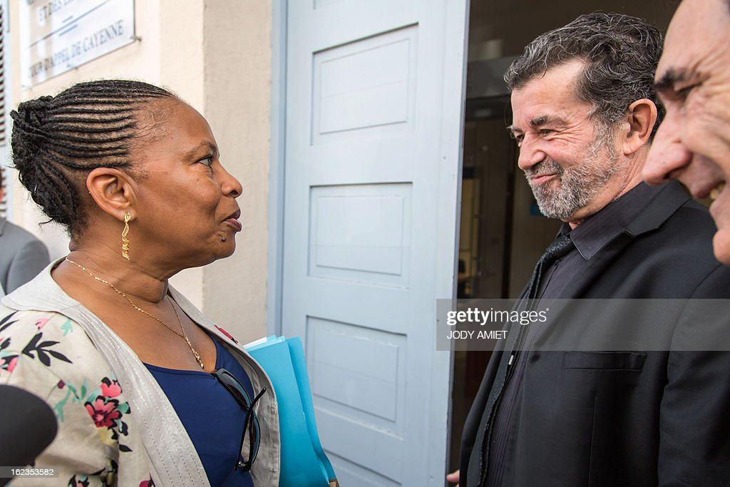 French Justice Minister Christiane Taubira (L), speaks with the president of the Court of Appeal Pierre Gouzenne (L) before a meeting at he headquarters of the Court of Appeal in Cayenne, on February 22, 2013, as part a five-day oficial visit in Guiana. AFP PHOTO JODY AMIET