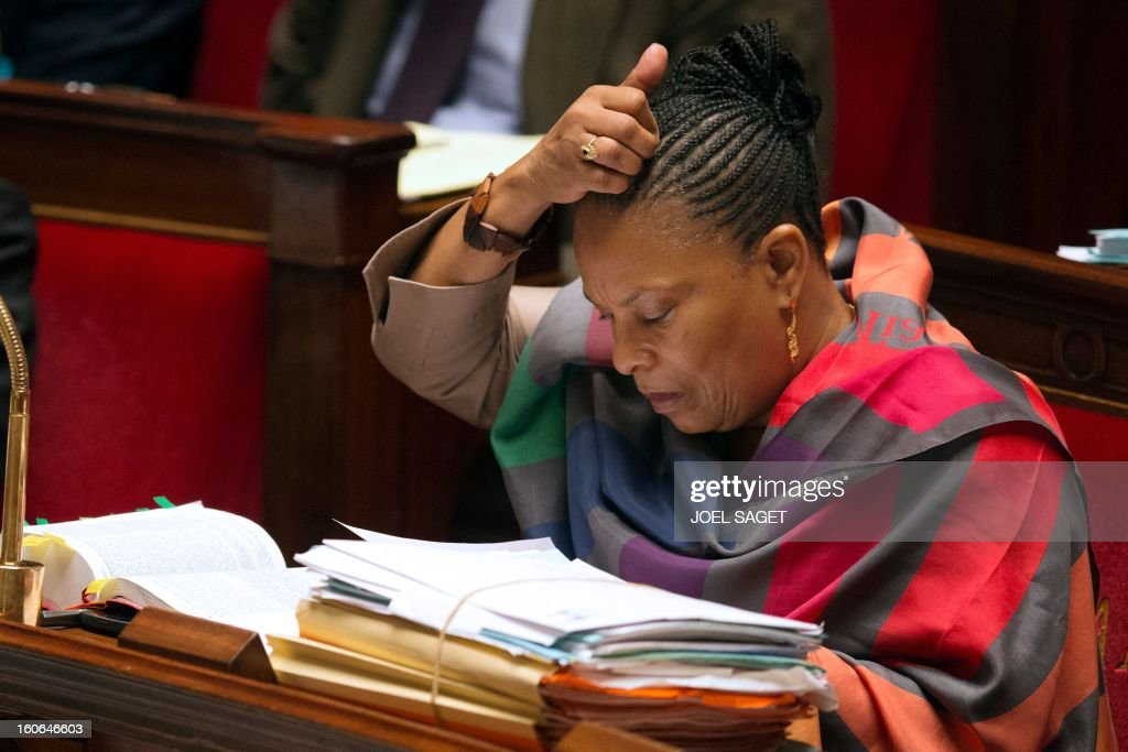 French Justice Minister Christiane Taubira takes part in the debate to allow gay couples to get married and adopt children on February 4, 2013 at the National Assembly in Paris. Two days before, Members of Parliament voted 249-97 in favour of Article One of the draft law, which redefines marriage as being a contract between two people rather than necessarily between a man and a woman.