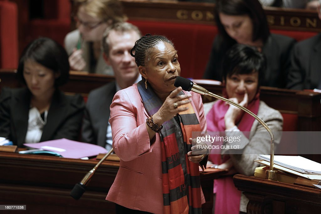 French Justice Minister Christiane Taubira takes part in the debate to allow gay couples to get married and adopt children on February 5, 2013 at the National Assembly in Paris. Three days before, members of Parliament voted 249-97 in favour of Article One of the draft law, which redefines marriage as being a contract between two people rather than necessarily between a man and a woman. AFP PHOTO FRANCOIS GUILLOT
