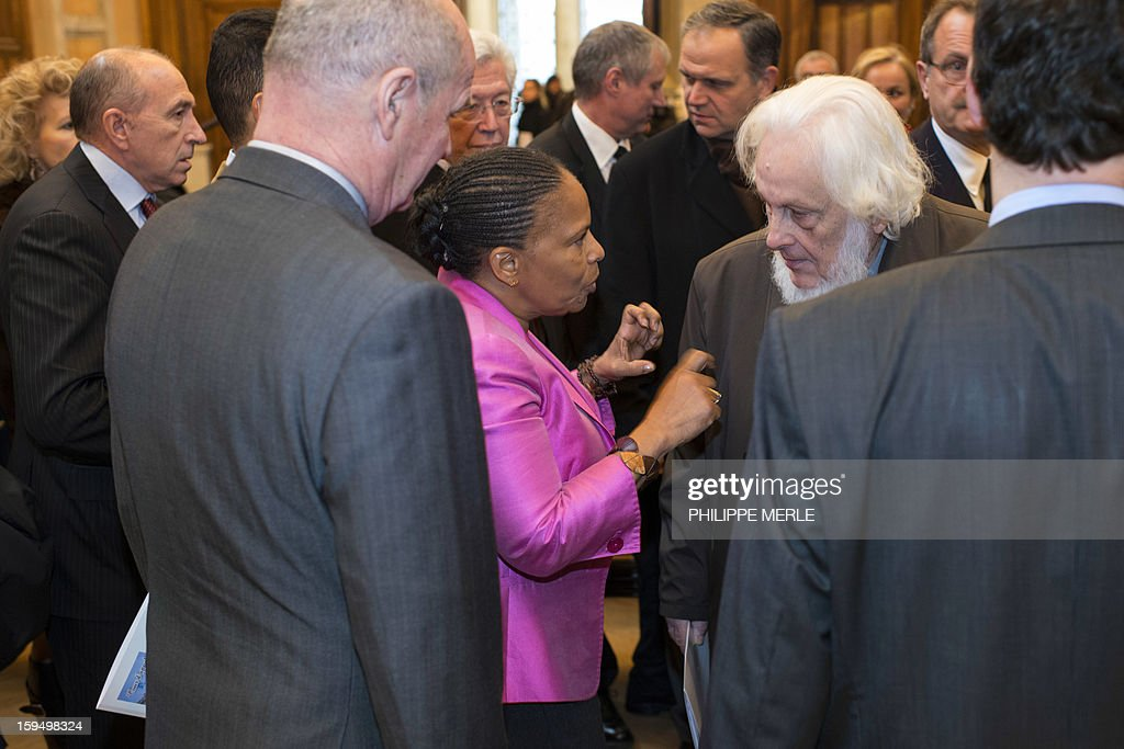 French Justice Minister Christiane Taubira (C) talks to former magistrate Pierre Truche (C,R), on January 14, 2013 in Lyon, in central France, as she attends a ceremony during a formal sitting of the appeal court, to inaugurate the Courthouse, after a four-year revamp.