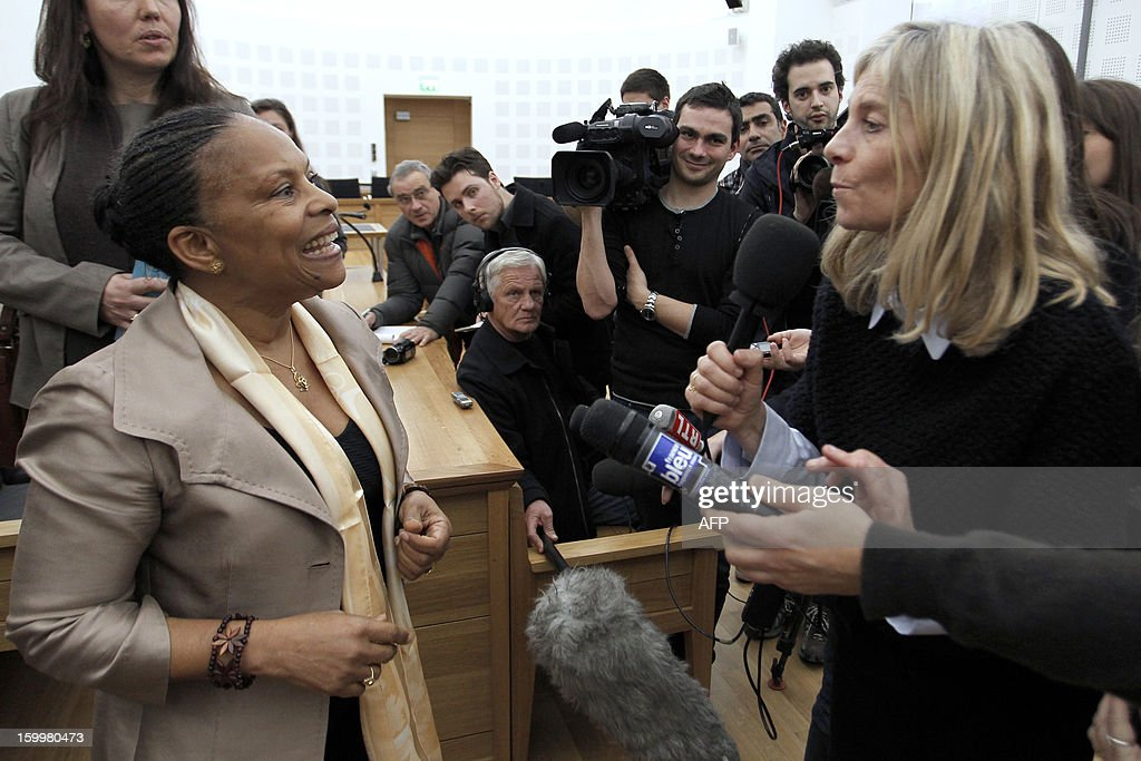 French Justice Minister Christiane Taubira (L) talks to journalists after a meeting with member of the Corsican assembly on January 24, 2013, in Ajaccio, Corsica, during a visit on the island focusing on new measures taken against organized crime.