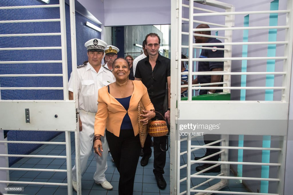 French Justice minister Christiane Taubira (C) visits the central prison of Remire-Montjoly, on February 25, 2013, as part of her five-day visit to the French overseas territory of Guiana.
