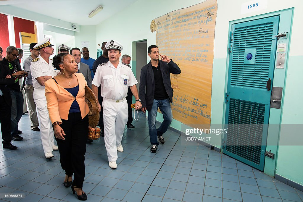French Justice minister Christiane Taubira (L) visits the central prison of Remire-Montjoly, on February 25, 2013, as part of her five-day visit to the French overseas territory of Guiana.