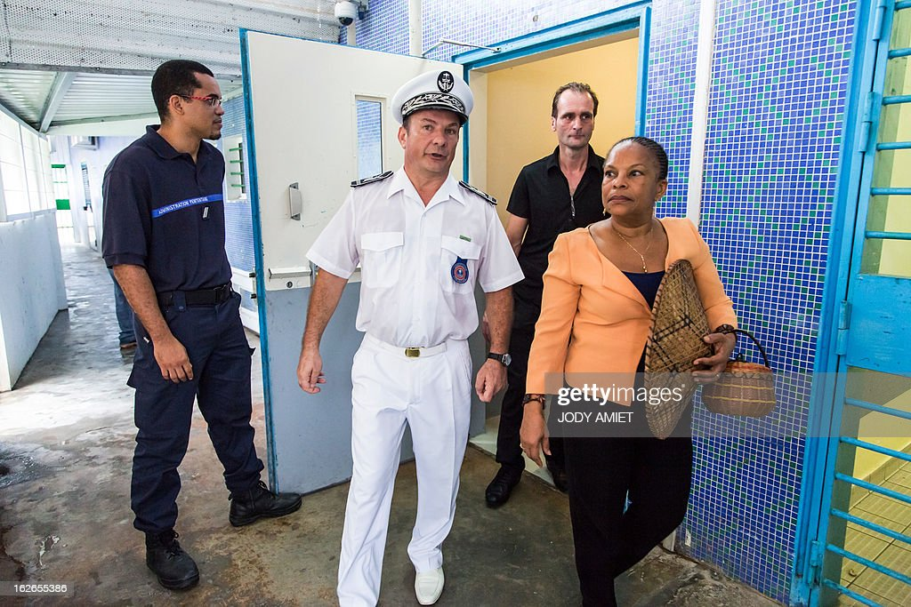 French Justice minister Christiane Taubira (R) visits the central prison of Remire-Montjoly, on February 25, 2013, as part of her five-day visit to the French overseas territory of Guiana.
