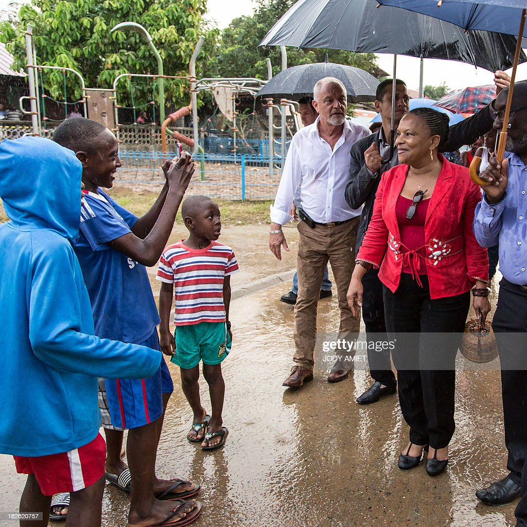 French Justice minister Christiane Taubira (R) visits the neighbourhood of Saramaca, on February 23, 2013 in Kourou, as part of her five-day visit to the French French overseas territory of Guiana.