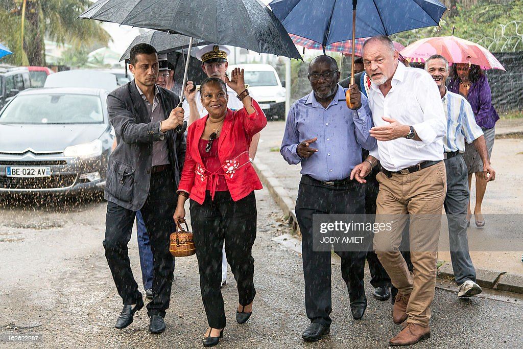 French Justice minister Christiane Taubira (C) visits the neighbourhood of Saramaca, on February 23, 2013 in Kourou, as part of her five-day visit to the French French overseas territory of Guiana. AFP PHOTO JODY AMIET