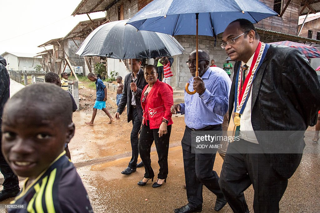 French Justice minister Christiane Taubira (C) visits the neighbourhood of Saramaca, on February 23, 2013 in Kourou, as part of her five-day visit to the French French overseas territory of Guiana.