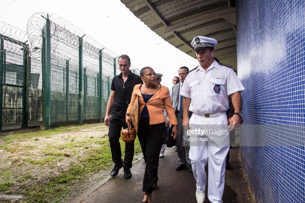 French Justice minister Christiane Taubira visits the prison of Remire-Montjoly with Daniel Willemot (R), head of the prison on February 25, 2013, in the French overseas territory of Guiana.