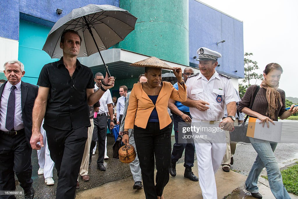 French Justice minister Christiane Taubira (C) visits the prison of Remire-Montjoly with Daniel Willemot (R), head of the prison on February 25, 2013, in the French overseas territory of Guiana. AFP PHOTO JODY AMIET