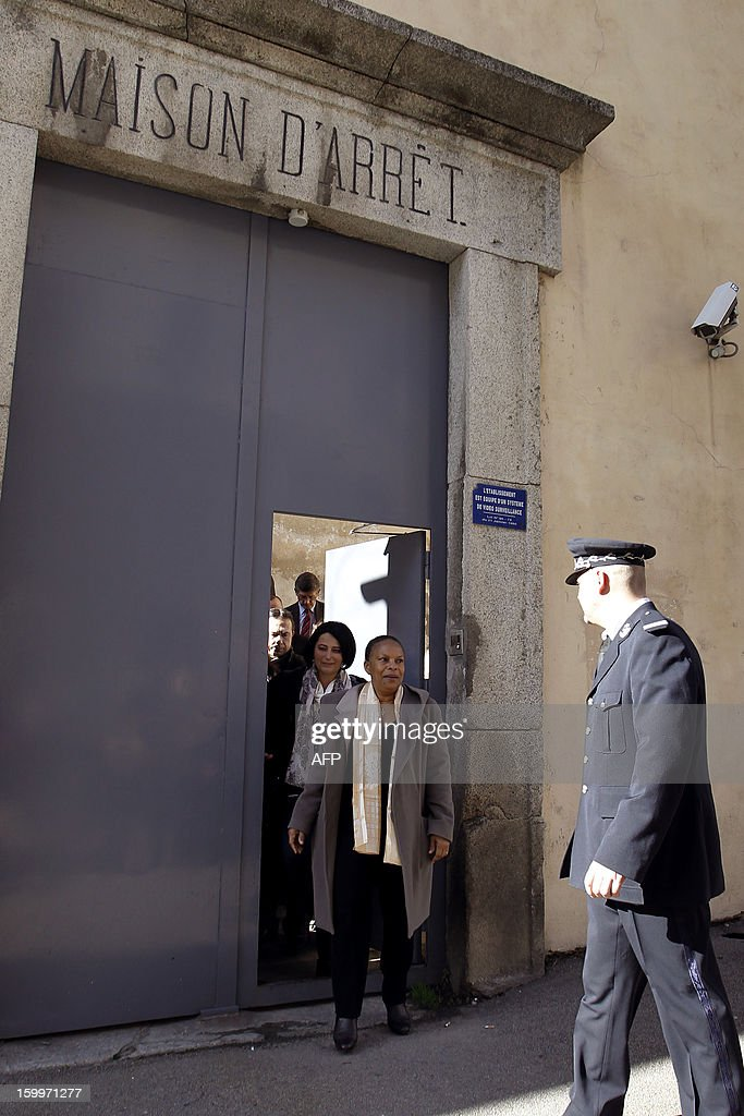 French Justice Minister Christiane Taubira (C) walks out the Ajaccio's prison following a visit on January 24, 2013, in Ajaccio, French mediterranean island of Corsica.