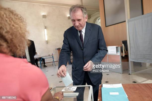 French Justice Minister Francois Bayrou casts his ballot at a polling station in Pau southwestern France on June 18 during the second round of the...