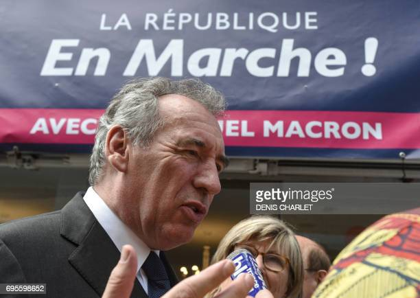 French Justice Minister Francois Bayrou speaks to journalists during his visit of support for the candidate for La Republique en Marche party...