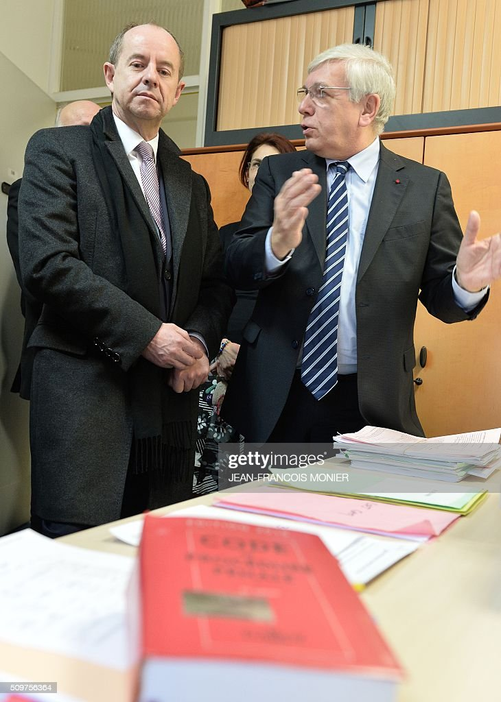 French Justice Minister Jean-Jacques Urvoas (L) and Chartres public prosecutor Marc Robert are pictured during Urvoas' visit to the Regional Court (TGI) of Chartres on February 12, 2016. / AFP / JEAN-FRANCOIS MONIER