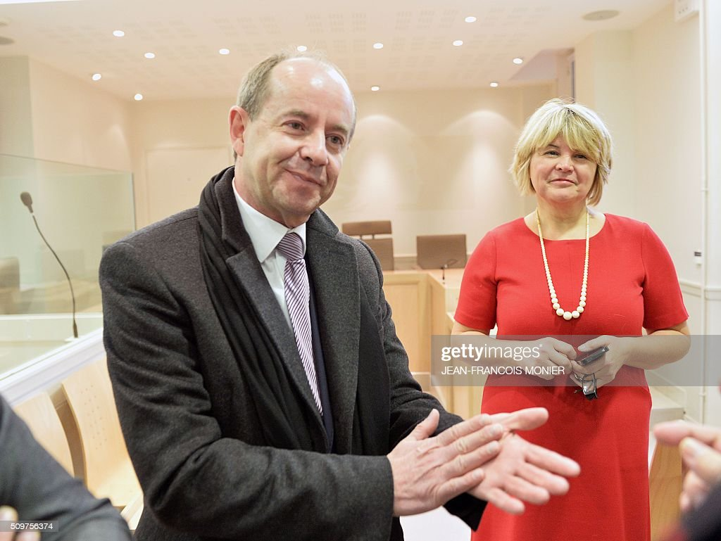 French Justice Minister Jean-Jacques Urvoas (L) and the President of the Chartres Regional Court (TGI) Françoise Barbier-Chassaing are pictured during Urvoas' visit to the Regional Court (TGI) of Chartres on February 12, 2016. / AFP / JEAN-FRANCOIS MONIER