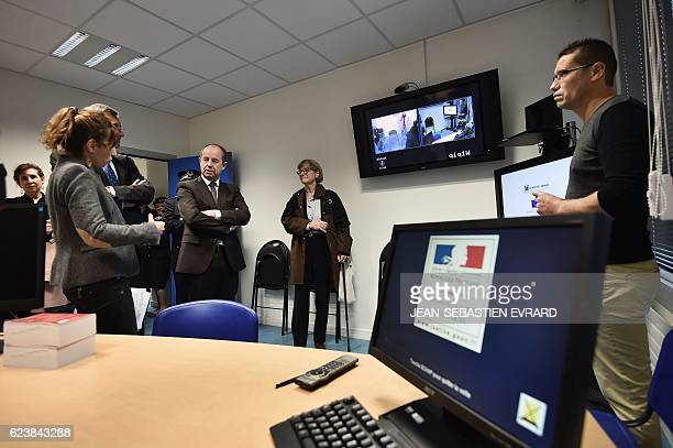 French Justice Minister JeanJacques Urvoas listens to explanations as he visits a confrontation room at the courthouse of Angers western France on...