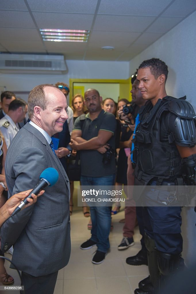 French Justice Minister Jean-Jacques Urvoas (L) meets with prison wardens (R) as he tours the Ducos prison on June 30, 2016 during the inauguration of the extension of the Ducos prison in Ducos, near Fort-de-france, on the Caribbean island of Martinique. / AFP / Lionel CHAMOISEAU