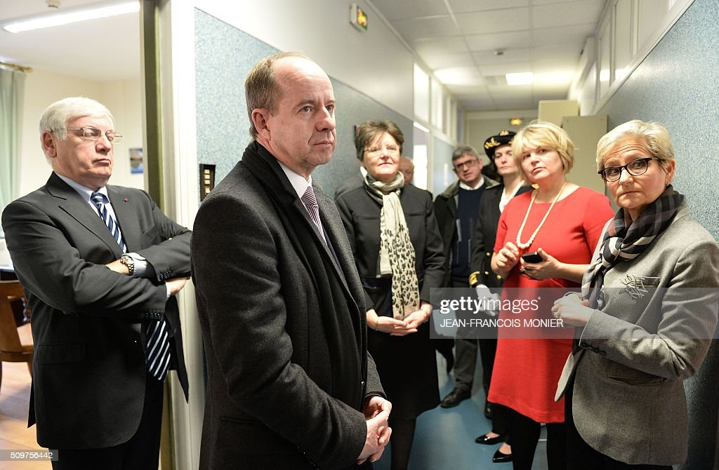 French Justice Minister Jean-Jacques Urvoas (2nd L), President of the Chartres Regional Court (TGI) Françoise Barbier-Chassaing (2nd R), Chartres' court public prosecutor Marc Robert (L) and Chartres' court First President Dominique Lotti (R) are pictured during Urvoas' visit to the Regional Court (TGI) of Chartres on February 12, 2016. / AFP / JEAN-FRANCOIS MONIER