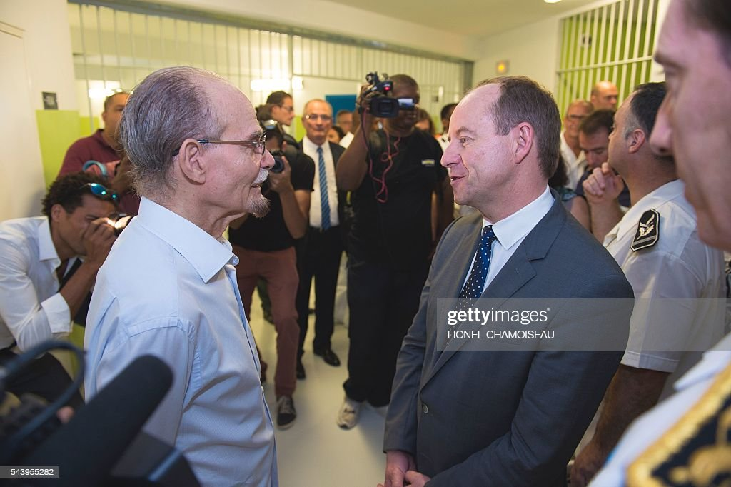 French Justice Minister Jean-Jacques Urvoas (R) spaeks with French mawmaker Alfred Marie-Jeanne (L)prison wardens (R) on June 30, 2016 during the inauguration of the extension of the Ducos prison in Ducos, near Fort-de-france, on the Caribbean island of Martinique. / AFP / Lionel CHAMOISEAU