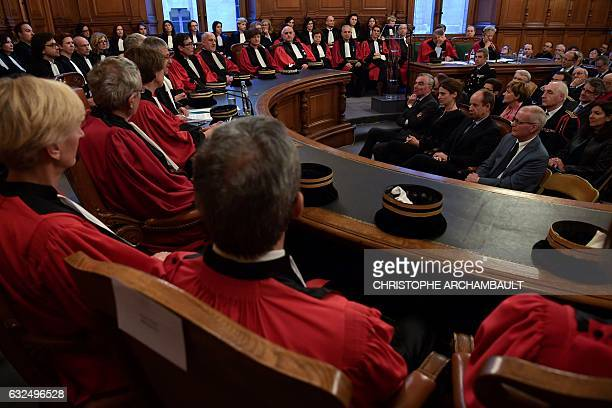 French Justice minister JeanJacques Urvoas speaks with junior minister in charge of victims' support Juliette Meadel attend the solemn hearing to...