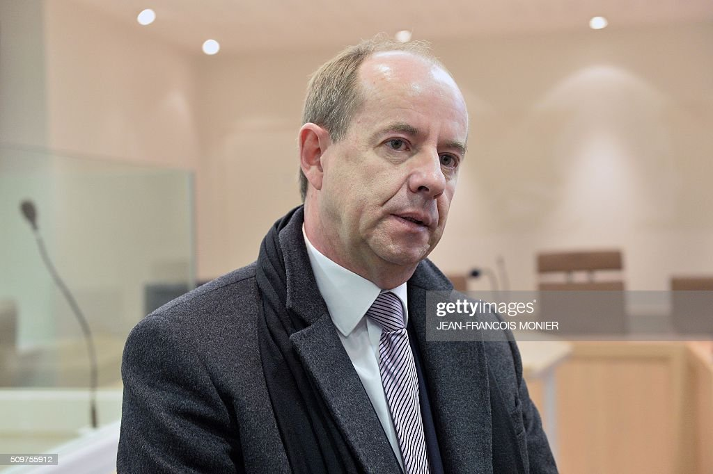 French Justice Minister Jean-Jacques Urvoas stands in a courtroom during his visit to the Regional Court (TGI) of Chartres on February 12, 2016. / AFP / JEAN-FRANCOIS MONIER