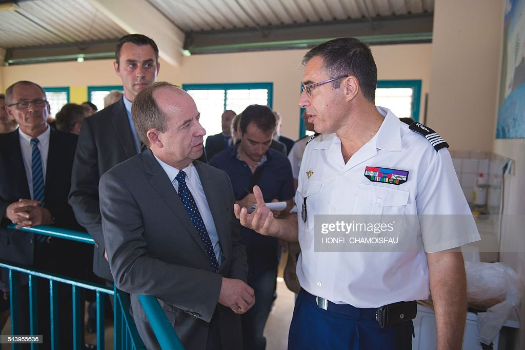 French Justice Minister Jean-Jacques Urvoas (L) talks with the Martinique Gendarmerie Colonel, Francois Agostini as they tour the Ducos prison with prison director Bruno Coulon (2nd R) on June 30, 2016 during the inauguration of the extension of the Ducos prison in Ducos, near Fort-de-france, on the Caribbean island of Martinique. / AFP / Lionel CHAMOISEAU