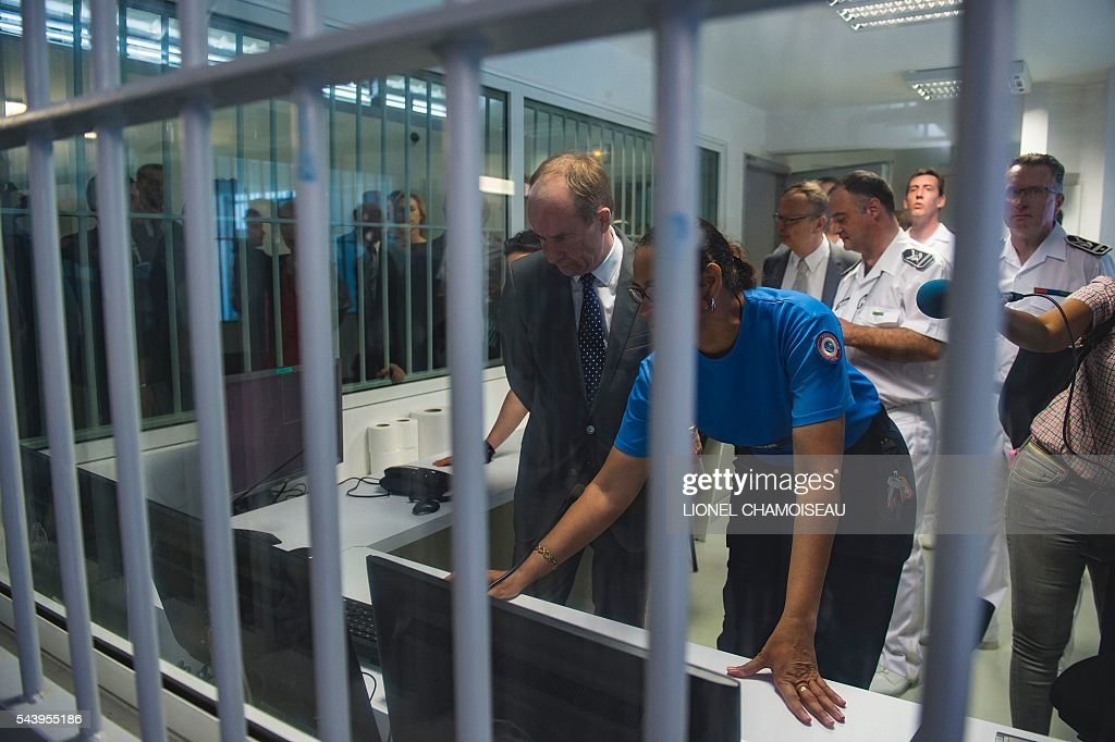 French Justice Minister Jean-Jacques Urvoas (L) tours the Ducos prison on June 30, 2016 during the inauguration of the extension of the Ducos prison in Ducos, near Fort-de-france, on the Caribbean island of Martinique. / AFP / Lionel CHAMOISEAU