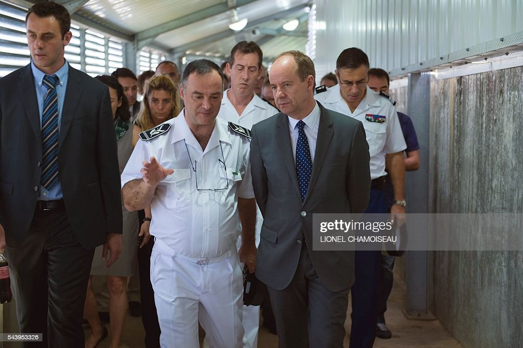 French Justice Minister Jean-Jacques Urvoas (R) tours the Ducos prison with prison director Bruno Coulon (C) and Martinique prefect Fabrice Rigoulet-Roze (Rear C) on June 30, 2016 during the inauguration of the extension of the Ducos prison in Ducos, near Fort-de-france, on the Caribbean island of Martinique. / AFP / Lionel CHAMOISEAU