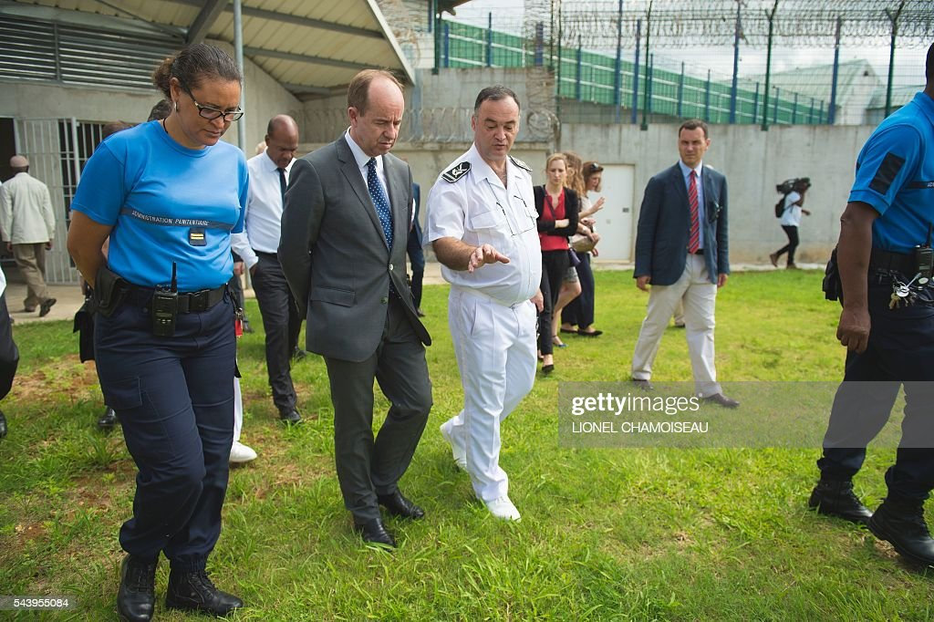 French Justice Minister Jean-Jacques Urvoas (2nd L) tours the Ducos prison with prison director Bruno Coulon (C) on June 30, 2016 during the inauguration of the extension of the Ducos prison in Ducos, near Fort-de-france, on the Caribbean island of Martinique. / AFP / Lionel CHAMOISEAU