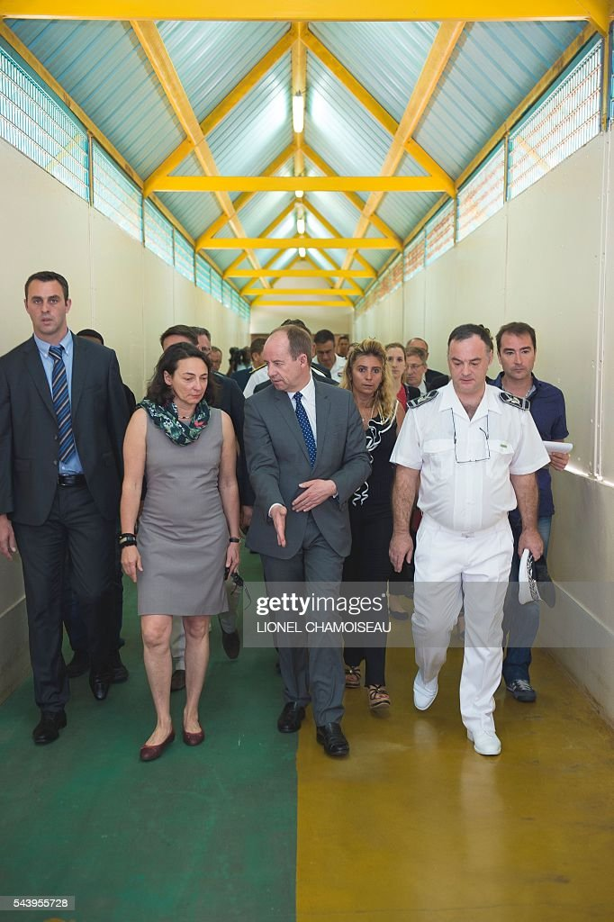 French Justice Minister Jean-Jacques Urvoas (C) tours the Ducos prison with prison director Bruno Coulon (R) on June 30, 2016 during the inauguration of the extension of the Ducos prison in Ducos, near Fort-de-france, on the Caribbean island of Martinique. / AFP / Lionel CHAMOISEAU