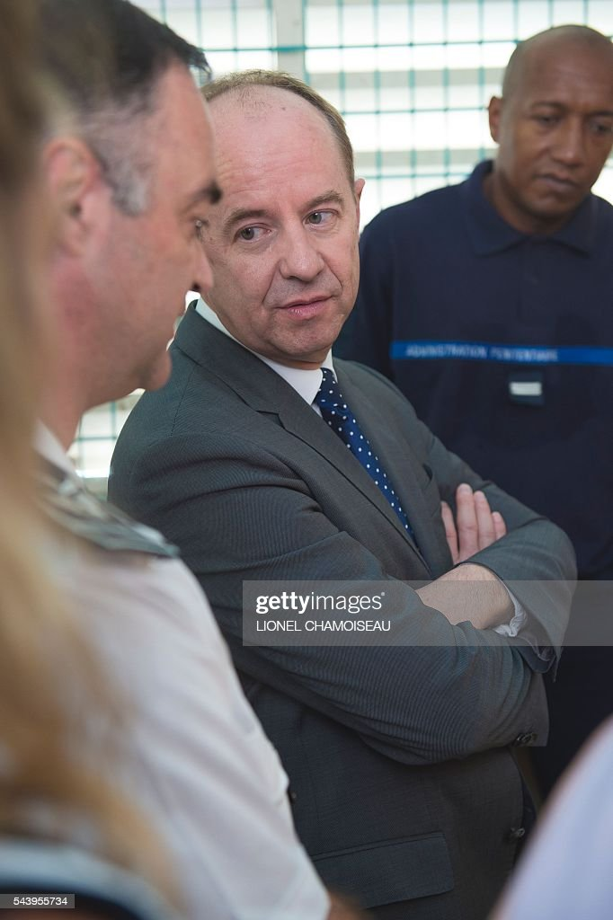 French Justice Minister Jean-Jacques Urvoas (C) tours the Ducos prison with prison director Bruno Coulon (L) on June 30, 2016 during the inauguration of the extension of the Ducos prison in Ducos, near Fort-de-france, on the Caribbean island of Martinique. / AFP / Lionel CHAMOISEAU