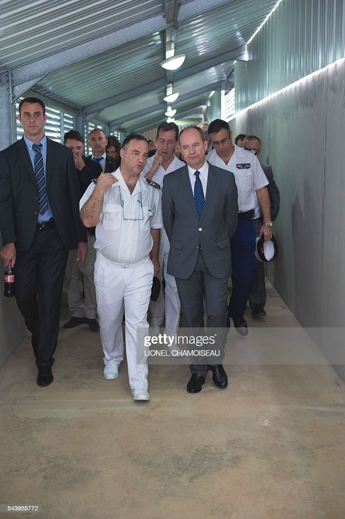 French Justice Minister Jean-Jacques Urvoas (R) tours the Ducos prison with prison director Bruno Coulon (L) on June 30, 2016 during the inauguration of the extension of the Ducos prison in Ducos, near Fort-de-france, on the Caribbean island of Martinique. / AFP / Lionel CHAMOISEAU