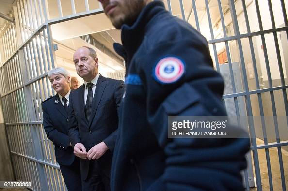 French Justice minister JeanJacques Urvoas visits the Baumettes prison with its director Christelle Rotach in Marseille southern France on December 9...