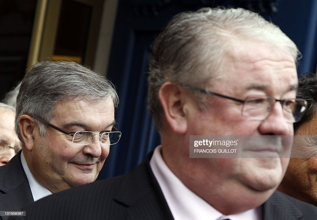 French Justice Minister Michel Mercier (L) and French former interior minister Daniel Vaillant attend a ceremony to unveil a plaque to mark the building where French entertainer Henri Salvador had lived for 46 years, 6 place Vendome in Paris, on November 9, 2011.