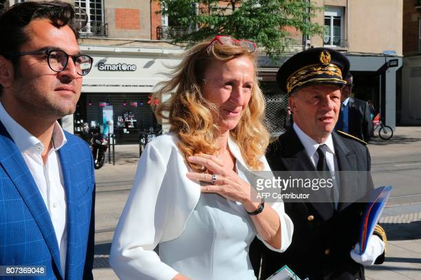 French Justice Minister Nicole Belloubet flanked by Reims Mayor Arnaud Robinet and Marne prefect Denis Conus arrive for a visit at the Tribunal de...