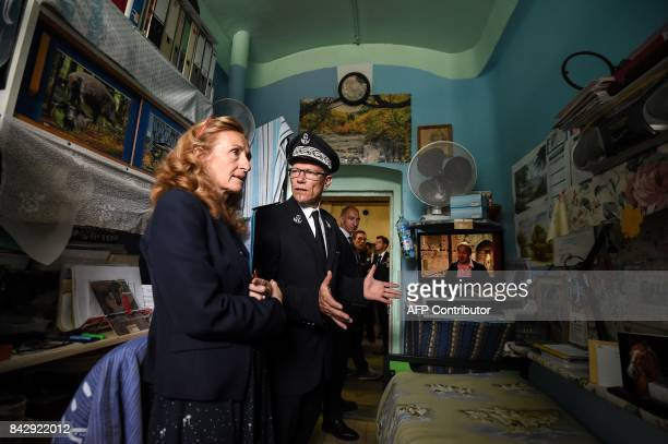 French Justice Minister Nicole Belloubet listens to the explanations of the prison director Guillaume Goujot as they visit a cell at the central...