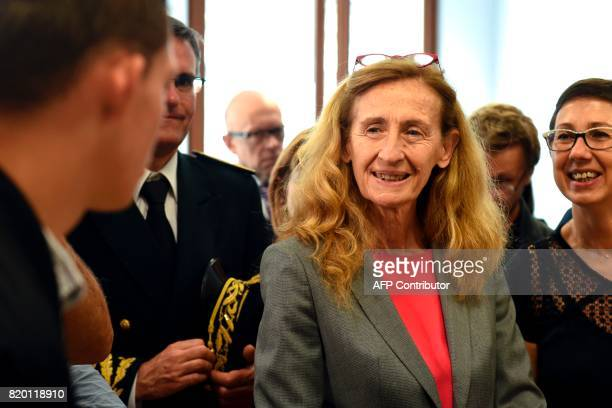French Justice Minister Nicole Belloubet speaks with a man as she arrives on July 21 2017 in Arras to meet the youth at the UEHC / AFP PHOTO /...